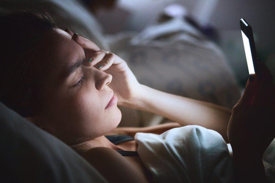A woman rubbing her eyes.