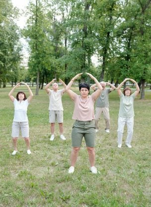 A bunch of people doing qigong for beginners.