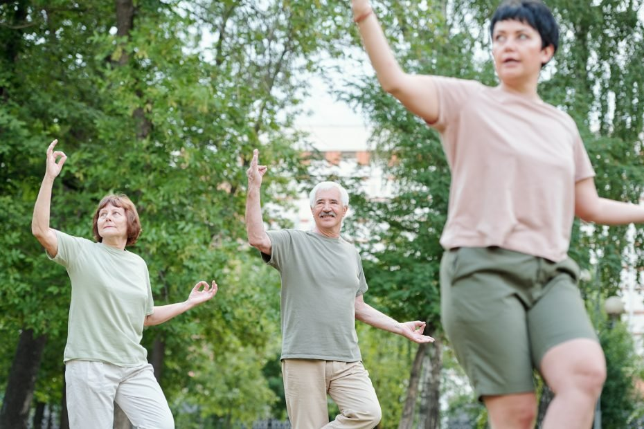 3 people doing qigong for beginners exercises.