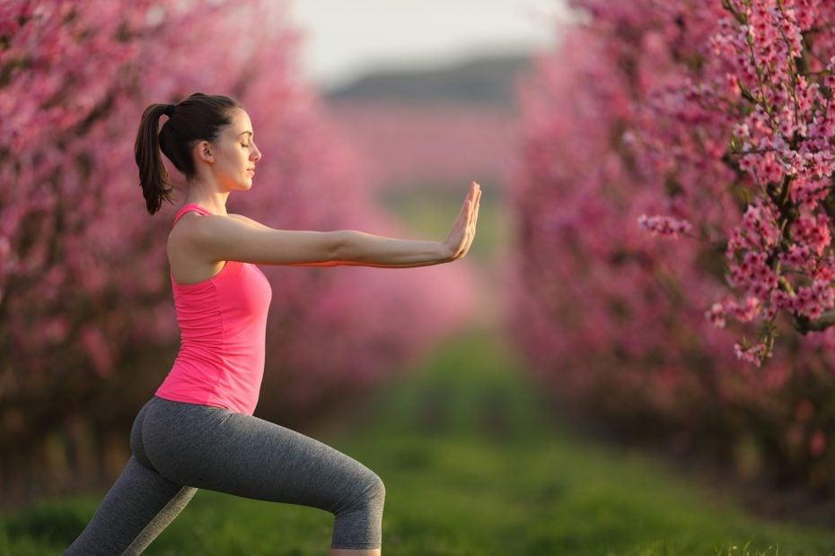 A woman doing Qigong for beginners.