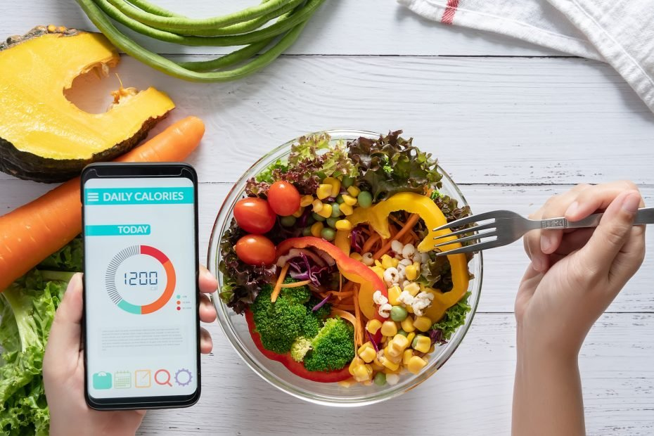 A woman counting calories using an app.