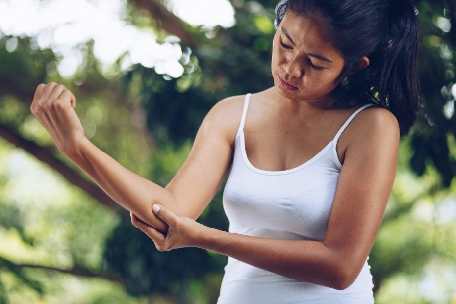 A woman holding her elbow.