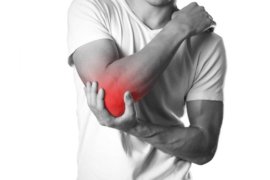 A man grabbing his elbow.