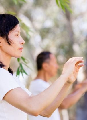 People in the park doing qigong for elbow and wrist pain.