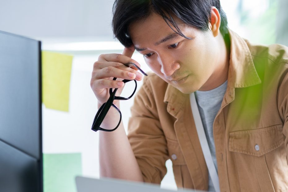 Asian business man working with computer in office.