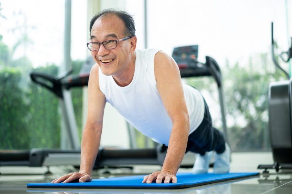 An Asian man doing Qigong.