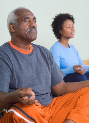 Two people meditating.