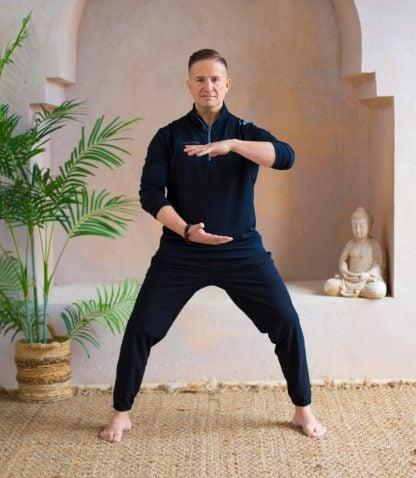 Bodhi Batista doing Qigong in a studio.