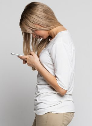A woman with her head down texting.